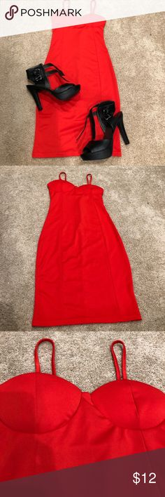 """Sexy Red Mini Dress Never been worn. Super sexy red form fitting dress. Padded bra area. 30"""" from top of chest area. Zipper on the back. Great for a night out! Show stopper Dresses Midi"""
