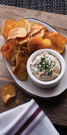 Caramelized Onion Dip with Thick-Cut Potato Chips | Enjoy this tasty appetizer featuring fresh, house-made chips and our ever-famous Royal Caribbean onion dip that's sure to leave you wanting seconds.
