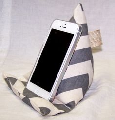 LOVE this! Im going to buy everyone I know one for Christmas. So many fun colors to choose from! Phone Stand Phone Holder Fabric Pillow Wedge by peachykeenday