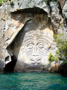 Lake Taupo Carvings, New Zealand. Maori rock carvings at Mine Bay on Lake Taupō, over 10 metres high and are only accesable by boat or Kayak.