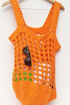 Great big, bright orange beach bag (or it will tote whatever you like).  Crocheted with cotton yarn, can be machine washed & dried.