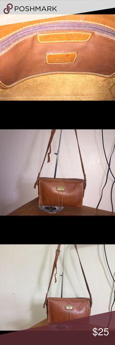 "Liz Claiborne brown leather crossover bag Lia Claiborne brown leather crossover bag Bag is in great condition no rips no stains  Bag measures 10""W x 7""H x 1""D strap drop 25"" Liz Claiborne Bags Crossbody Bags"