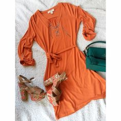 Michael Kors dress Tangerine Michael Kors dress. Stretchy material in medium will fit a small relaxed or a medium more fitted. Flatters the best curves. Stretch material never fades. Beautiful silver hardware with designer stamp. Amazing summer/spring dress. MICHAEL Michael Kors Dresses Mini