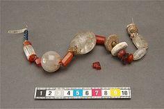 Grave find from Birkas Black Earth. 25 beads:, 4 rock crystal, 3 carnelian, 5 amber, 1 alabaster, 1 marlek ( a nonsilicate mineral), 1 fossil and 10 glass. Föremål 422678. SHM 474:5b