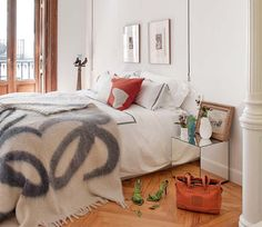City apartment: doors, light, bedding, side table. Lived-in feel but very casual and organic.