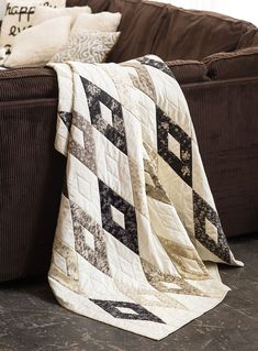 STRIPPY DIAMONDS by Jean Nolte: We walk you through cutting out parallelograms and diamonds for this throw featuring 2 1/2″ strips from the Gentle Flowers collection by Quilt Gate. The neutral diamond shapes really showcase the brown prints in the quilt.
