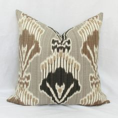 Bold Ikat print in brown & charcoal on taupe background. Same fabric and pattern on both sides. Fits pillow insert selected in menu.Actual pillow