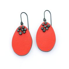 Colourful laminate drop earrings combining a minimalist shape with handmade oxidised silver dot details on the front. Light grey laminate is used on the reverse.  Size: approx. 50mm (L) x 21mm (W) x 4mm (D)  Also available in teal, orange, yellow, white, light grey, dark grey, and black.