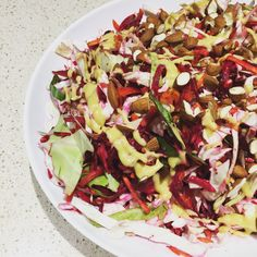 Last night's crunchy slaw with a pomegranate and Dijon dressing. Super simple, super crunchy and super healthy!