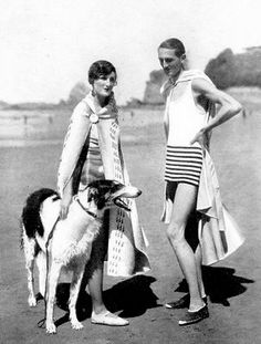 A couple with their flash borzoi on the beach at Cote des Basques, Biarritz, France, in 1928.