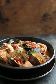 Classic San Francisco seafood stew—Cioppino, made with clams, mussels, shrimp, fish, and Dungeness crab in a tomato-based broth. So good! On SimplyRecipes.com
