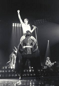 Freddy Mercury, on Darth Vaders shoulders, both looking stoic as shit. Badass.