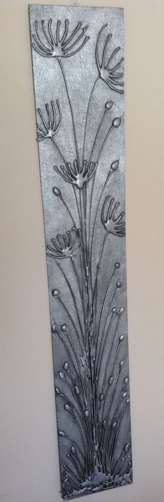 Hot Glue Gun Art - Spray painted with Metallic Silver, distressed with black paint - giving it an antique metal look.