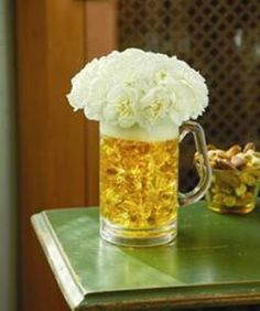 """Oktoberfest party decorations: Beer mug filled with amber-colored acrylic rocks. White mini carnations form the """"foam. Oktoberfest Party, Oktoberfest Decorations, Beer Party Decorations, Oktoberfest Recipes, Birthday Decorations For Men, Retirement Decorations, Balloon Decorations, Wedding Decoration, Super Bowl Party"""
