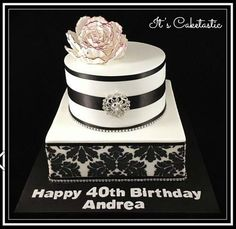 Two tiers of black and white gorgeousness for this 40th birthday cake with just a hint of burgundy on the peony to match the invitations.