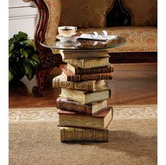 Books Stacked and glued together to make a Side Table ( you can get the glass tops at Pier One or Hobby Lobby)