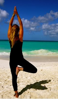 tree pose in a peaceful setting like a beach or near a waterfall...yoga in nature :)
