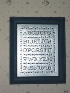 Alphabet Sampler - punched tin