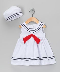 Ahoy, matey! Little sweeties can set sail for fun wearing this nautical outfit. Well-crafted in a classic silhouette, it's got darling details, from its sailor collar to its stripe-trimmed hem. An adorable matching hat lends extra charm and sun coverage. Note: Infant sizes include bloomers.
