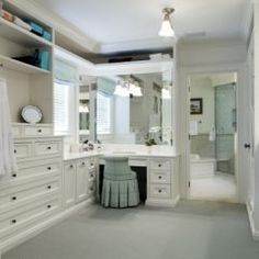 I prefer a dressing room combining the makeup area, closet space, and dressing area off the master bedroom/bath.