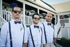 The combination of suspenders, bow ties, and wayfarer sunglasses ...