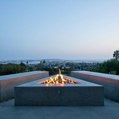 Concrete fire pit with corner seating and view, Silva studios architecture complete a renovation of a mid-century modern house in San Diego bays, US