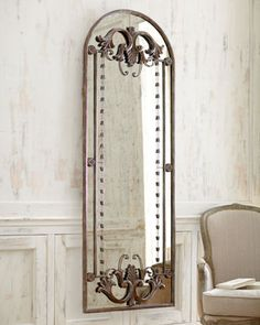 """Antiqued Door-Frame Mirror - Horchow  Rosettes, flourishes, and other decorative elements add depth and glamour to this stately arched mirror.  Frame and embellishments made of resin and metal.  Mirror backed by wood composite.  Hand-painted dark-bronze finish.  30""""W x 1.5""""D x 80""""T.  Imported. $1025.00"""