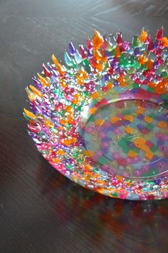 Just need to work out what pony beads are now! Melted Pony Bead Bowl- put beads between an oven safe bowl and a smaller bowl. bake at 350 degrees for hour Cute Crafts, Crafts To Make, Easy Crafts, Crafts For Kids, Arts And Crafts, Melted Bead Bowl, Melted Pony Beads, Melted Bead Crafts, Pony Bead Crafts