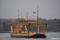 """Download the royalty-free photo """"Ferry boat, Norrkoping, Sweden"""" created by Ciaobucarest at the lowest price on Fotolia.com. Browse our cheap image bank online to find the perfect stock photo for your marketing projects!"""