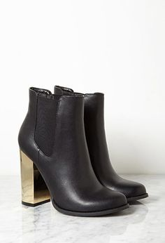 Because everyone and their mother owns a pair of black ankle booties, YOU need to step up your game with a little metallic heel action. BAM, look atchu go girl.