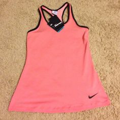 BNWT Nike pro tank! Beautiful, silky, soft Nike pro tank. It's like a coral peach color! Nike Tops Tank Tops