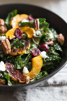 Thanksgiving Salad with Kale, Roasted Delicata Squash, Cranberries, goat cheese and spiced pecans. It can be made ahead too! #thanksgiving #salad #kalesalad #cranberries Delicata Squash Recipe, Acorn Squash, Thanksgiving Salad, Thanksgiving 2017, Healthy Snacks, Healthy Recipes, Paleo Food, Healthy Dishes, Veggie Food
