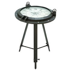 Both industrial and nautical, this DecMode Metal Clock Table marries the two design aesthetics beautifully. Its tarnished gray iron design includes.
