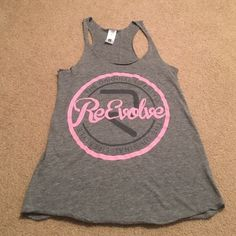 Grey Reevolve Workout Tank Grey tank with the Reevolve logo on the front. Only worn a few times! Reevolve Tops Tank Tops