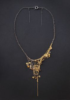 Necklace | Julia Berg. Crochet work with oxidized 925 italian silver chains, goldfilled chains, Smokey Quartz diamond cut beads & Ruliated Quartz chips