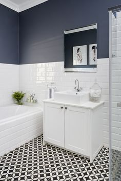 Jo'burg interior designer Kelly Adami, brought a tired bathroom up to date. Th… Jo'burg interior designer Kelly Adami, brought a tired bathroom up to date. This tired bathroom updated with a monochromatic scheme. Bathroom Renos, Bathroom Renovations, Metro Tiles Bathroom, Bathroom Makeovers, Bathroom Colors, Blue Bathroom Decor, Bathrooms Decor, Bathroom Showrooms, Condo Bathroom