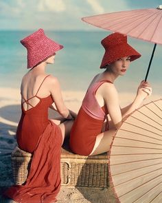 Red swimwear at beach by Louise Dahl-Wolfe