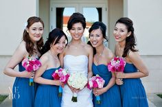 Bride and Bridesmaids with gorgeous blue and pops of pink