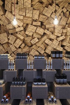 Aesop temporary shop at Singapore's Merci designed by March Studio. Gigantic installation of cardboard boxes suspended in a net.