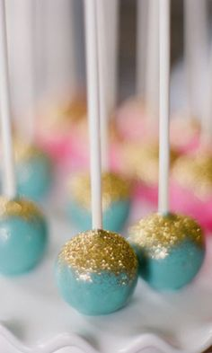 Use as escorts... Turquoise cake pops with gold glitter #wedding #turquoise #glitter #gold #cake #cakepops