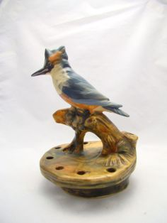 "Weller kingfisher flower frog 6.5"" - did not know Kingfishers were so popular in flower frogs"