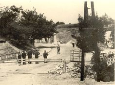 Theresienstadt, Jewish policemen standing by a barrier at the entrance to the ghetto, 1941-1945.