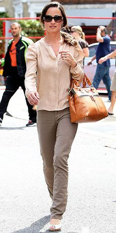 SO SHADY  Pippa plays with neutrals, wearing gradient shades of tan in her puff-sleeve button-up, skinny khakis, tan wedges and the camel version of her favorite carry-all while walking in London.