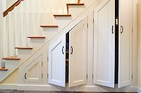 df024601_basement-remodel-storage-under-stairs-photo.jpg | HomeAndGardenPhotos.com