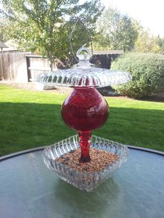 Glass bird feeder   Hey, I found this really awesome Etsy listing at https://www.etsy.com/listing/165770585/red-and-clear-glass-hanging-bird-feeder