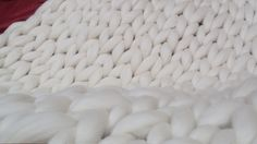 Handmade in USA with merino wool, this super chunky knit blanket is incredibly warm, cozy and wonderfully luxurious. Cuddle in its warm embrace or drape it decoratively over your bed, chair or sofa. Makes quite a statement! Freinds and Family will compliment your blanket and want to