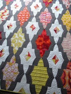 Sew Kind Of Wonderful: Metro Medallion quilt by Jenny Pedigo. Love the colors and the fun design, but I'm really enamored of the stitching--especially on the white and gray.