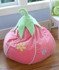 Strawberry Beanbag by Heart to Heart. It's ridiculously expensive though, so I would try to make a look-a-like. :) But so cute! Especially for the whimsical/fairy room I want for the Girls.