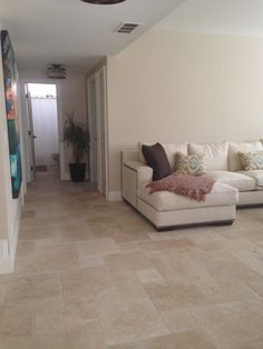 Hazelnut Versailles Pattern Travertine Living Room Remodel. Lighter tan and cream tone natural stone tile. Comes in Brushed Chiseled Edge or Tumbled finish