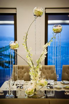 4 Ways to Make Your Centerpieces Unique - Modern Wedding Centerpieces of Varying Height {Style Me Pretty} - mazelmoments.com